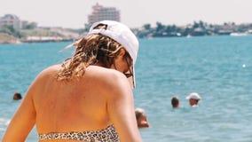 Beautiful girl sunbathing on a sandy tropical beach stock video