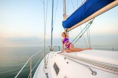 Beautiful girl sunbathing on the yacht. Stock Photo