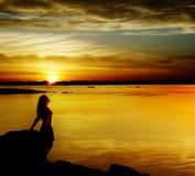 Beautiful girl  on sundown Royalty Free Stock Images