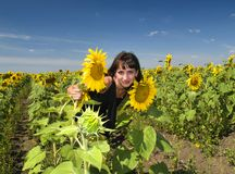 Beautiful girl between sunflower Royalty Free Stock Image