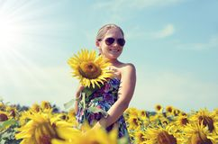 Beautiful girl in the sunflower field. Royalty Free Stock Photography