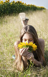 Beautiful girl with sunflower Stock Photography