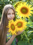 Beautiful girl with sunflower Royalty Free Stock Photos