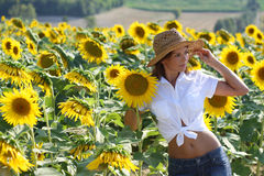 Beautiful girl with sunflowers Stock Photo
