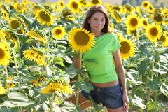 Beautiful girl with sunflowers. Portrait of a Beautiful girl with sunflowers Stock Photo