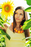 Beautiful girl among the sunflowers. Portrait of beautiful girl among the sunflowers Royalty Free Stock Photos