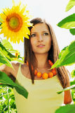 Beautiful girl among the sunflowers Royalty Free Stock Photos