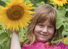 Beautiful  girl and sunflowers Stock Images