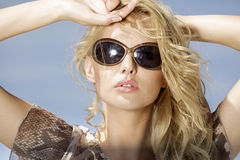 Beautiful girl in sunglasses Stock Photography