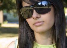 Beautiful girl with sunglasses. Beautiful girl with dark sunglasses Royalty Free Stock Photography