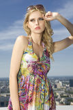 Beautiful girl in sunglasses on blue sky Stock Image