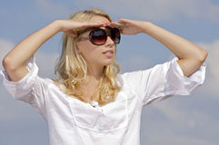Beautiful girl in sunglasses on  blue sky Stock Image
