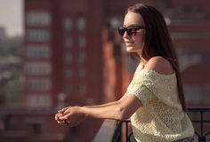 Beautiful girl in sunglasses enjoying the freshness. Royalty Free Stock Images