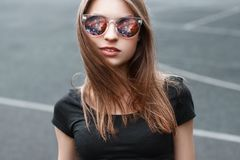 Beautiful girl in sunglasses. In the glasses reflection of space. Pretty cosmos girl Royalty Free Stock Photos