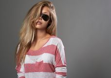 Beautiful girl in sunglasses on gray background Stock Image