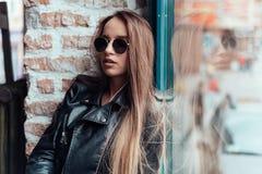 Beautiful girl in sunglasses posing on camera Stock Photos