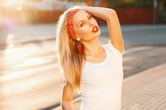 Beautiful girl with sunglasses and a red armband. Pin-Up Style. Art Stock Images