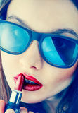 Beautiful girl in sunglasses with red lips Royalty Free Stock Photography