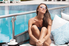 Beautiful girl in sunglasses relaxing with coffee Royalty Free Stock Photo