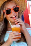 Beautiful girl in sunglasses and slush on beach. Vertical Royalty Free Stock Photos