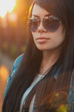 Beautiful girl in sunglasses. sunlight  sunset Royalty Free Stock Photos
