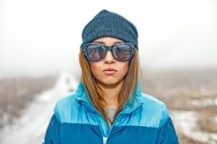 Beautiful girl in sunglasses in a winter