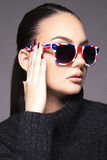 Beautiful girl with sunglasses. Beautiful young girl holding sunglasses close up face beauty concept royalty free stock photos
