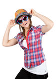 Beautiful girl in sunglasseses and colour hat Stock Image