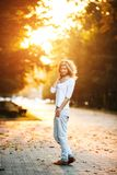 Beautiful girl in sunset light. Beautiful girl posing in autumn park on camera Royalty Free Stock Photography