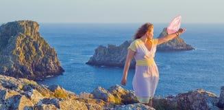The beautiful girl at sunset, Pen Hir, Bretagne Royalty Free Stock Images