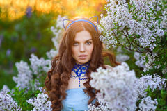 Beautiful girl in sunset in the spring park Lilac Stock Photos