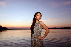 Beautiful girl  at sunset time. Beautiful girl  in a dress on the beach at sunset time Royalty Free Stock Image