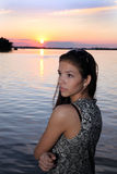 Beautiful girl  at sunset time. Beautiful girl  in a dress on the beach at sunset time Royalty Free Stock Images