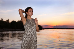 Beautiful girl  at sunset time. Beautiful girl  in a dress on the beach at sunset time Royalty Free Stock Photos