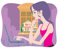Beautiful girl surf the web. A good looking young woman browse the web through a laptop Stock Image