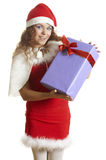 Beautiful girl is surprised to a christmas gift Royalty Free Stock Photo