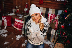 Beautiful girl in sweater gloves hats New Year Stock Photos