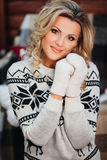 Beautiful girl in sweater gloves  New Year with Stock Photos