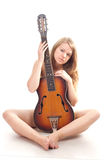 Beautiful girl in a sweater with guitar Stock Photography