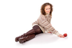 Beautiful girl in a sweater sitting Royalty Free Stock Photos
