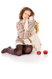 Beautiful girl in a sweater sitting with apples Stock Photos