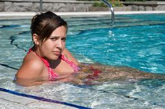 Beautiful girl in the swimming pool Royalty Free Stock Image