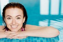 Beautiful girl in a swimming pool Royalty Free Stock Photo