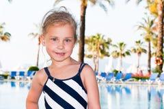 Beautiful girl at the swimming pool. Beautiful girl posing at the swimming pool Royalty Free Stock Image