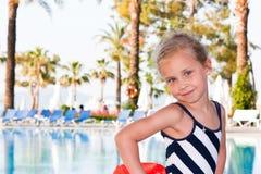 Beautiful girl at the swimming pool Stock Photos