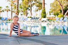 Beautiful girl at the swimming pool. Beautiful girl posing at the swimming pool Royalty Free Stock Photos