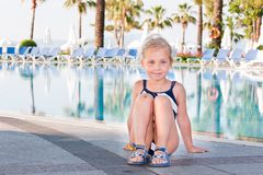 Beautiful girl at the swimming pool Stock Images