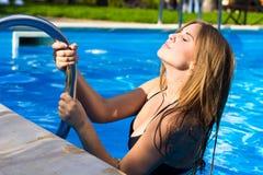 Beautiful girl at swimming pool. Outdoor Stock Image