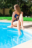 Beautiful girl at swimming pool. Outdoor Royalty Free Stock Photo