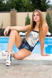 Beautiful girl at swimming pool. Outdoor Royalty Free Stock Image